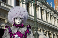 Venetian costume attends Carnival of Venice. Royalty Free Stock Photos