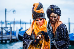 VENICE, FEBRUARY 10: An unidentified couple in typical dress poses during traditional Venice Carnival Stock Photos