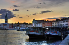 Venice, ferries at sunset royalty free stock photography