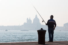 Venice - Fisherman from Riva S. Biagio waterfront Royalty Free Stock Photography