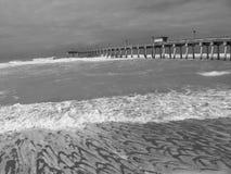 Venice FL Fishing Pier. Surf receding at Venice Fishing Pier in Venice Florida royalty free stock photos