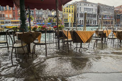 Venice during a flood. Flooded restaurant on the waterfront of Grand Canal Stock Image