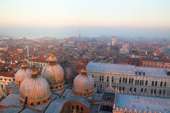 The Venice in fog at sunset. This is the whole city was black fog.The sunset dyed the sky red Stock Photography
