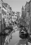 Venice - Fondamenta Giardini street and boats. Stock Photos
