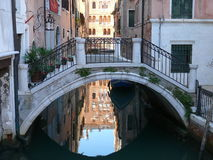 Venice. Footbridge over one of beautiful Venetian canal Royalty Free Stock Photography