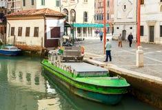 Venice. Garbage barge Stock Image
