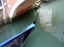 Venice Gondola. Gondola front on Venetian Canal Stock Photo