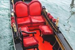 Venice gondola. Details of gondola is on the water background. Venice. Italy. Stock Photos