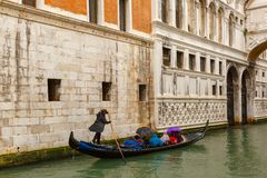 Venice gondola in rainy weather, Italy Royalty Free Stock Photo