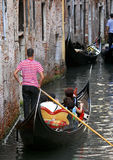 Venice - Gondola Series. Part of the make-up of Venice are the Gondolas and the Gondaliers. They are often waiting for jams ahead Stock Image