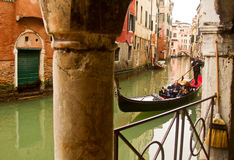 Venice gondola on small canal stock images
