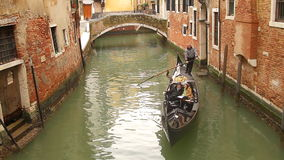Venice gondola on small canal stock video footage