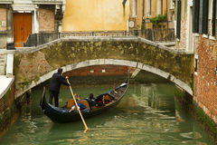 Venice gondola under bridge Royalty Free Stock Image