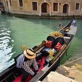 Venice. Gondola at the wharf Stock Image