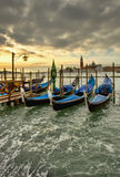 Venice gondolas. Venice grunge scene with gondolas at sunset Royalty Free Stock Images