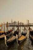 Venice gondolas. Gondolas on the canal in Venice. Italy. Brown colors Royalty Free Stock Images