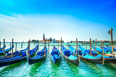 Venice, gondolas or gondole and church on background. Italy Stock Photo