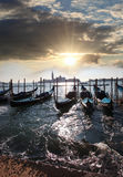 Venice with gondolas in Italy. Venice with gondolas against sunset in Italy Royalty Free Stock Image