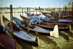 Venice. Gondolas moored by Saint Mark square at sunrise. Venice, Italy. Filtered image, vintage effect applied Royalty Free Stock Photos