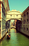 Venice. Gondolas passing over Bridge of Sighs Royalty Free Stock Photography