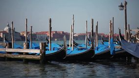 Venice, gondolas  and San Giorgio Maggiore church landmark on background. Italy, Europe. stock video