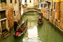 Venice gondolas on small canal stock images