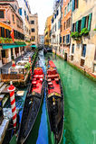 Venice gondolas. Gondolas waiting for the tourists on the narrows canals of Venice. Italy Royalty Free Stock Photos
