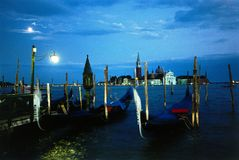 Venice gondole at dusk. Venice at dusk: the most beautiful town in the world. Made in Italy stock images