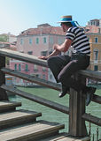 Venice gondolier. A venetian gondolier at rest on Accademia bridge, Venice, Italy Royalty Free Stock Photography