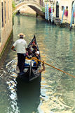 Venice gondolier driving gondola Stock Images
