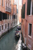 Venice Gondolier floating on a traditional venetian canal Stock Image