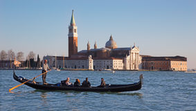 Venice - Gondolier on the lagoon and San Giorgio Maggiore church in evening light Stock Images