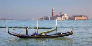 Venice - Gondolier on the lagoon and San Giorgio Maggiore church in evening light Royalty Free Stock Images