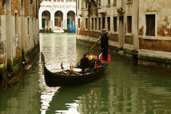Venice gondolier on small canal Stock Photography