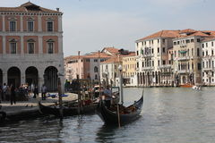 Venice Gondolier in a traditional venetian canal Stock Image