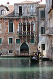 Venice Gondolier in a traditional venetian canal Stock Images