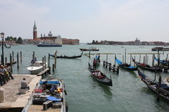 Venice Gondolier and the traditional Venice fluvial landscape Royalty Free Stock Photography