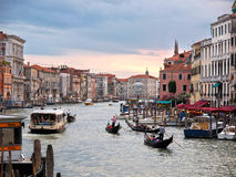 Venice - Grand Canal. VENICE - July 1: The tourism season starts, and tourist and locals travel in Gondolas and boats on the Grand Canal of Venice, Italy July 1 Royalty Free Stock Photography