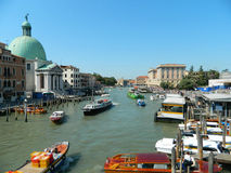 Venice grand canal or Canal Grande, view from first bridge. Venice grand canal or Canal Grande, view from first bridge, including a lot of boats, taxis and Royalty Free Stock Photos