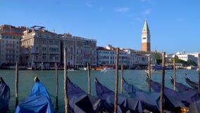 Venice Grand Canal. In Venice, Italy. Gondolas near the pier. View of Campanile di San Marco. 4K stock video footage