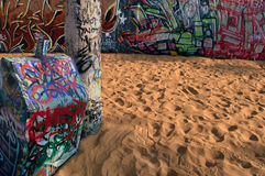 Venice Graphitti. Venice beach wall and trash can over sand Stock Photography