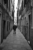 Venice is growing old. An old man walking alone Stock Photo
