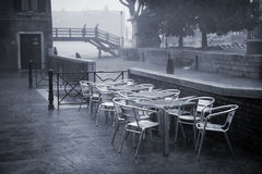 Venice in heavy rain. It is raining cats and dogs in Venice, Italy - Duotone Royalty Free Stock Image