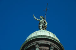 Venice 3. Historical domed roof featuring statue with blue sky background Stock Image
