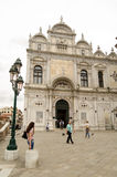 Venice Hospital. VENICE, ITALY - JUNE 10: Pedestrians walking in front of the magnificent facade of the main hospital in Venice on June 10 2013.  Despite the Royalty Free Stock Photography