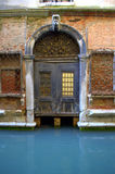 Venice house door at canal Stock Photography