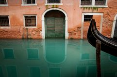 Venice house and Gondola. Typical house and boat in a Venetian canal Royalty Free Stock Image