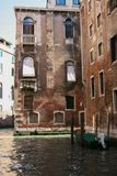 Venice, houses on the canal with moored boat stock photography