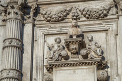 Venice 13. Intracate statues set amongst white stone historical church walls in venice Stock Photos