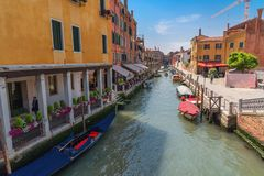 VENICE, ITALY – MAY 23, 2017: Traditional narrow canal street with gondolas and old houses in Venice, Italy. Royalty Free Stock Photography